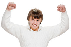 Exited young man raising clenched fist arm Royalty Free Stock Image