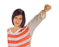 Exited young woman kicks air clenched fists arm Stock Image