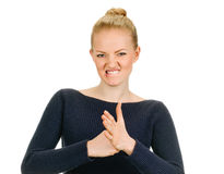 Exited young woman kicks clenched fist arm Royalty Free Stock Images