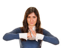 Exited young woman kicks clenched fist arm Royalty Free Stock Photography