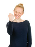 Exited young woman raising clenched fist arm royalty free stock photography