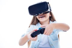 Happy excited girl using game console Royalty Free Stock Photos