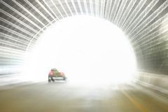 Exiting a road tunnel. Approaching the exit of a road traffic tunnel Stock Image