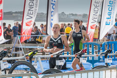 After exiting the water, athletes take their racing bike Royalty Free Stock Images