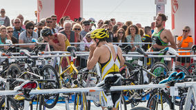 After exiting the water, athletes take their racing bike Stock Image