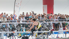 After exiting the water, athletes take their racing bike Stock Images