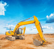 Exkavator on construction site and sky background Royalty Free Stock Photography