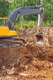 Exkavator digging clay Stock Photography