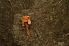 Exkavator im Graben Stockfotografie