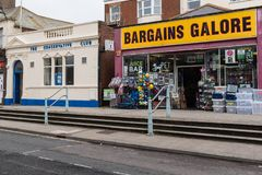 Exmouth, Devon, UK, April, 6th, 2019: The conservative club in Exmouth next to a Bargains Galore shop which may ring. Exmouth, Devon, UK, April, 6th, 2019: The stock photos