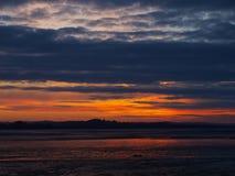 Exmouth solnedgång vid stranden i devon Royaltyfria Bilder