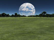 Exo. Alien world with another planet on horizon or earth with a terraformed moon Royalty Free Stock Images