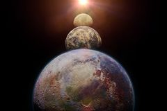 Exo planets lit by an alien sun. Habitable alien planets, a distant star system Royalty Free Stock Image
