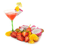 Exolic coctail and fruits. Some exotic coctail with fruits on the plates on the white background stock photos