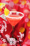 Exolic  fruits coctail   on the read. Some  exotic coctail on the red silk with sacra flowers brunch. Studio shoot Royalty Free Stock Photos