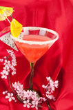 Exolic fruits coctail on the read. Some exotic coctail on the red silk with sacra flowers brunch. Studio shoot stock photos