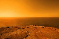 Exoplanet with vast ocean. Beautiful deserted planet with vast ocean in orange colors stock image