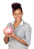 Exotic african girl with a money-box Royalty Free Stock Photography