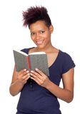 Exotic african girl reading a book Royalty Free Stock Photos