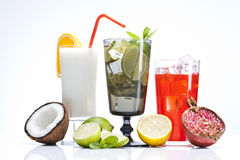 Exotic alcohol drinks set with fruits on white Royalty Free Stock Images