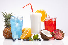 Exotic alcohol drinks set with fruits on white Stock Images