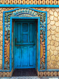 Exotic architecture. Home with exotic decoration on the wall with blue door in Jericoacoara village  - Jericoacoara National Park - State of Ceara - Brazil Stock Photography