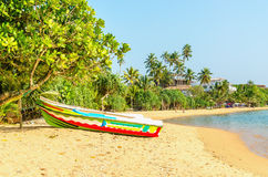Exotic Asian beach with colorful boat, Sri Lanka Royalty Free Stock Images