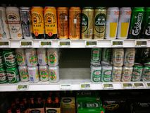 Exotic asian beers in gourmet supermarket Royalty Free Stock Image