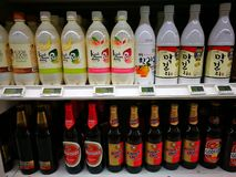 Exotic asian beers and rice wine in gourmet supermarket Stock Photo