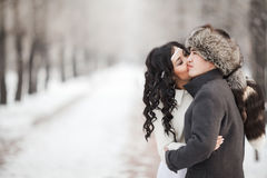 Exotic asian bride and groom kissing in middle of Stock Image