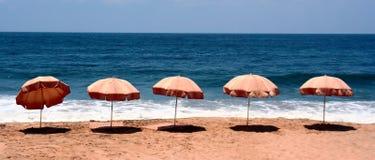 Exotic beach. Umbrellas on a deserted beach Royalty Free Stock Photo