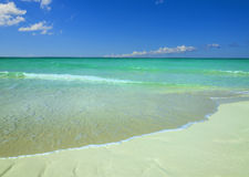 Exotic beach against blue sky, azure water, golden sand Royalty Free Stock Images