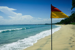 Exotic beach. With flag in Bali, Indonesia Stock Image
