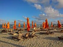 Exotic beach with orange umbrellas Royalty Free Stock Image