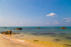 Exotic beach and rocks Stock Image