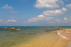 Exotic beach with sand and boat Stock Photography