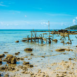 Exotic beach at Thailand with fishing gear at low tide Stock Photos