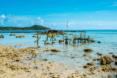 exotic beach in Thailand with fishing gear at low tide Royalty Free Stock Photography