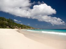 The exotic beach under the blue sky cloud Stock Image