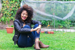 Exotic beautiful young girl relaxing in the garden Royalty Free Stock Photos