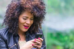 Exotic beautiful young girl using cell phone Stock Image