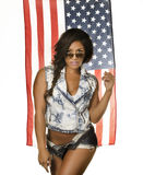 Exotic beautiful young woman in denim isa flag Royalty Free Stock Photos