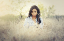 Exotic beautiful young woman in summer sunshine. Wearing denim Royalty Free Stock Images