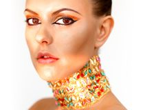 Exotic beauty. Gorgeous woman with bright makeup looking at camera Royalty Free Stock Image