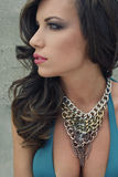 Exotic beauty 5. Beautiful brunet summer lady with necklace Royalty Free Stock Photo
