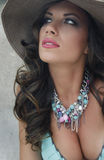 Exotic beauty. Beautiful brunet summer lady with necklace Royalty Free Stock Photos