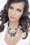 Exotic beauty 3. Beautiful brunet summer lady with necklace Stock Image