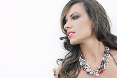 Exotic beauty. Beautiful brunet summer lady with necklace Stock Photo