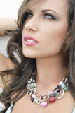 Exotic beauty. Beautiful brunet summer lady with necklace Stock Images