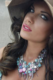Exotic beauty 1. Beautiful summer lady with hat and necklace Royalty Free Stock Photography